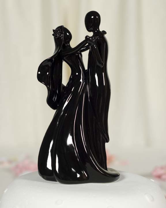 Stylized bride and groom figurine with black finish